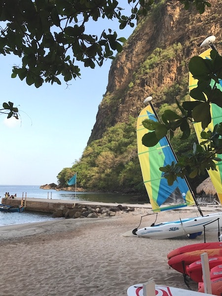 sugar beach saint lucia with wind surf boards showing some of the fun things to do in St. Lucia