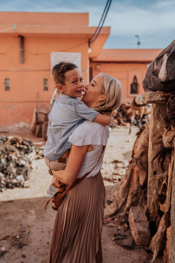 Mom and son hugging in Morocco