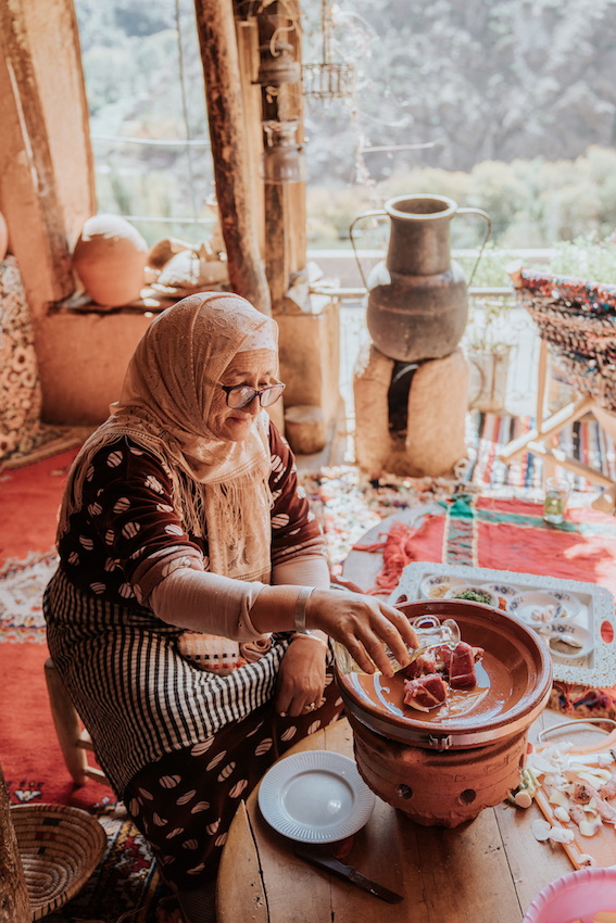 local moroccan women cooking in a tangine