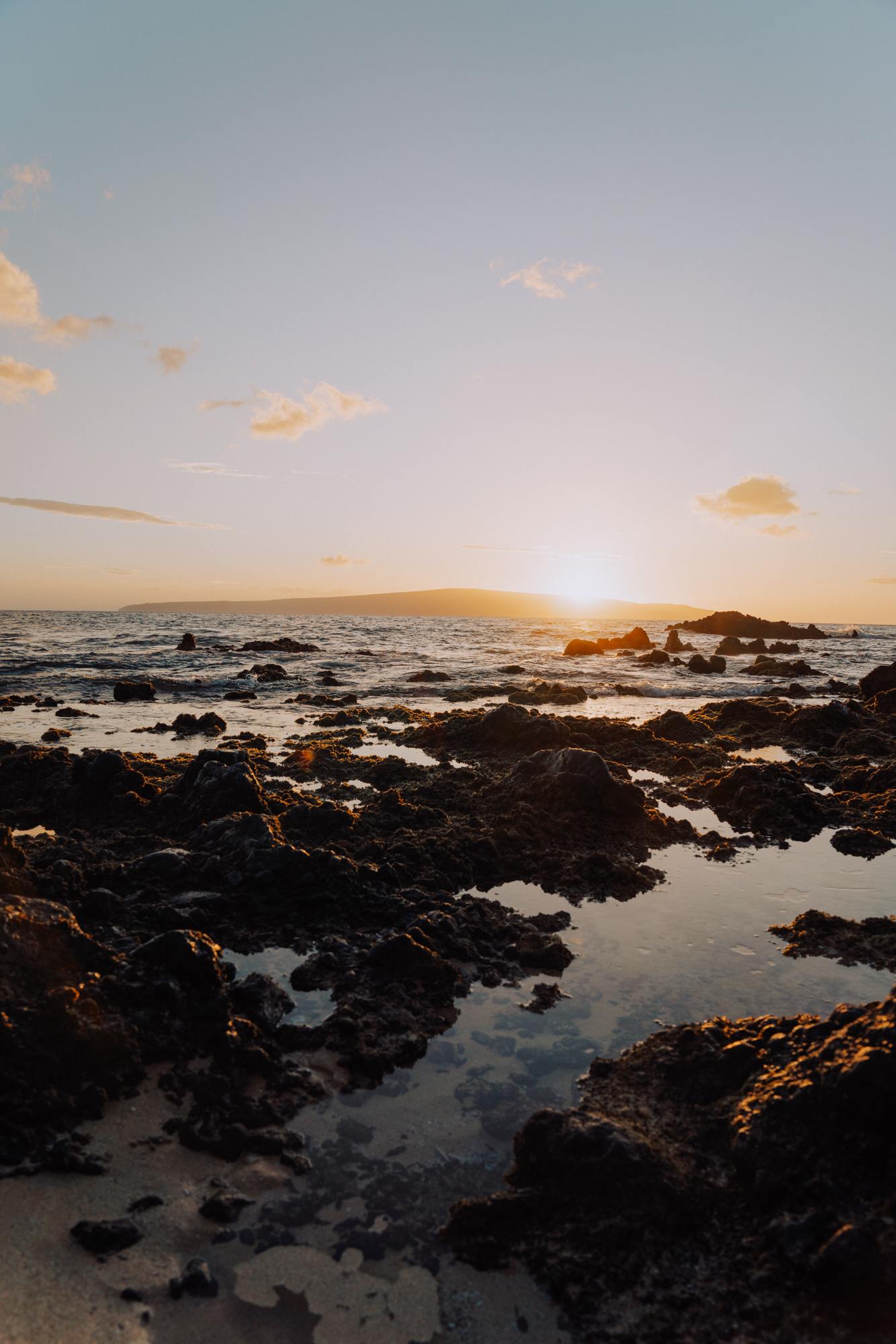 sunset over a rocky beach in Hawaii