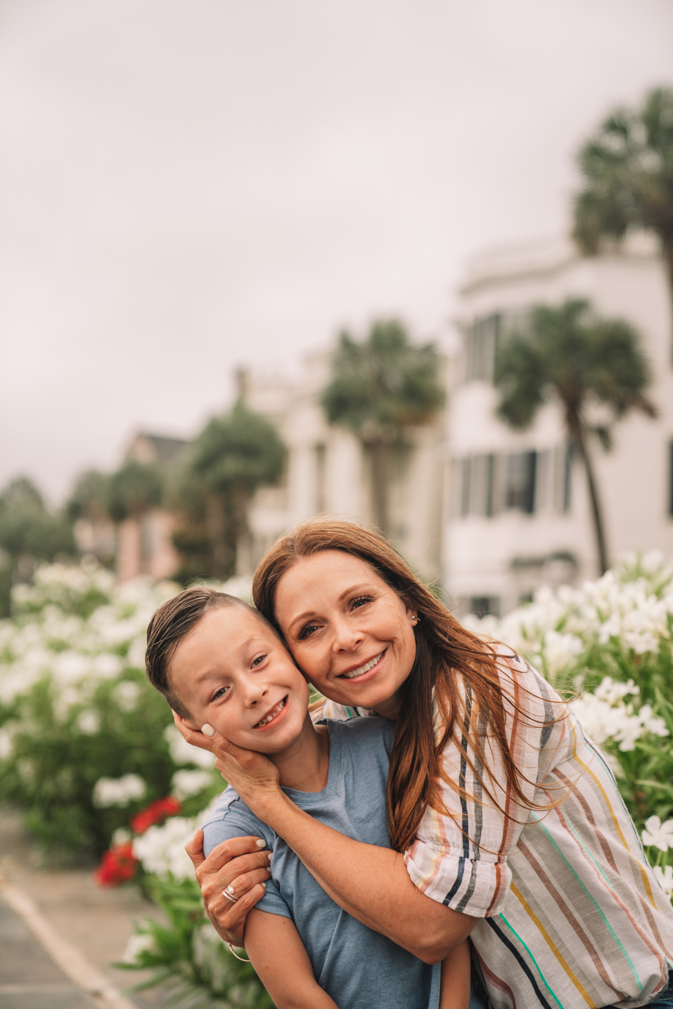 Things to do in Charleston sc with kids - a little boy and his grandma smile on the battery in Charleston.